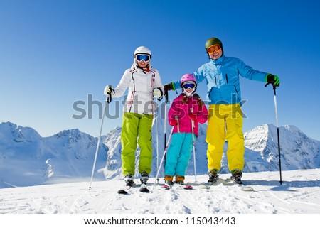 Skiing, winter - happy family ski team - stock photo