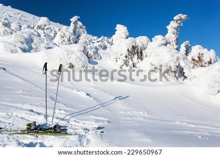 Skiing, winter season , mountains and ski equipments on ski run - stock photo