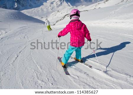 Skiing, winter, ski lesson - kid on mountainside - stock photo