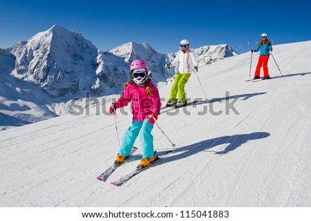 Skiing, winter, ski lesson - skiers on mountainside - stock photo