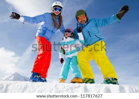 Skiing, winter, snow, sun and fun - family enjoying winter vacations - stock photo