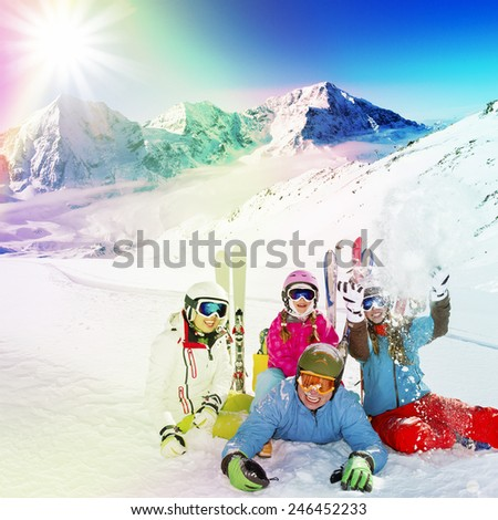 Skiing, winter sport - family enjoying winter vacations, filtered - stock photo