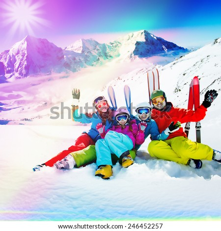 Skiing, winter sport - family enjoying winter vacations, filtered - stock photo