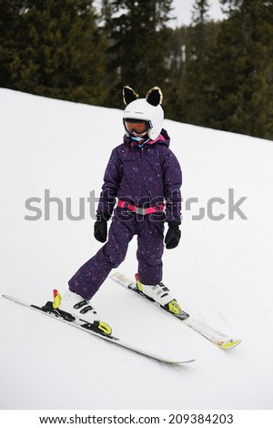 Skiing, winter sports- young kid girl skier on the forest slope - stock photo