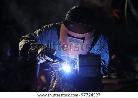 skilled working factory welder. - stock photo