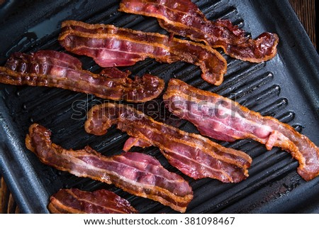 Skillet with fried Bacon (close-up shot and selective focus) - stock photo