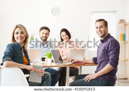 Skillful four colleagues are expressing positive emotions - stock photo