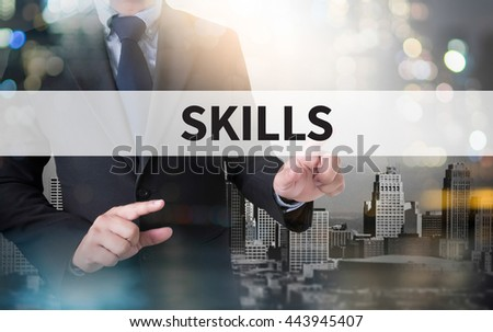 SKILLS and businessman working with modern technology - stock photo