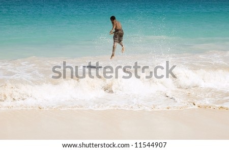 Skimboarder jumping wave. - stock photo