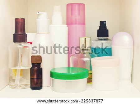 Skin Care cosmetics on the shelf in the closet. With selective focus - stock photo