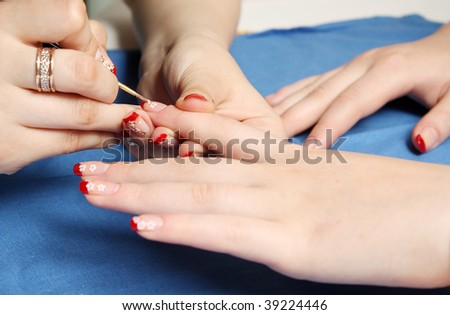 Skin care. Nail art in processing. - stock photo