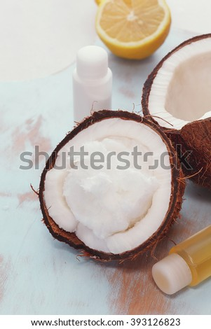 Skincare ingredients. Spa still life of organic coconut oil and fresh lemon. Macro selective focus, vintage toned image.    - stock photo