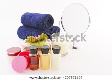 Skincare products isolated over white - stock photo