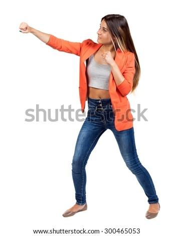 skinny woman funny fights waving his arms and legs. Isolated over white background. The girl in the red jacket standing in a boxing pose and hit his left hand. - stock photo