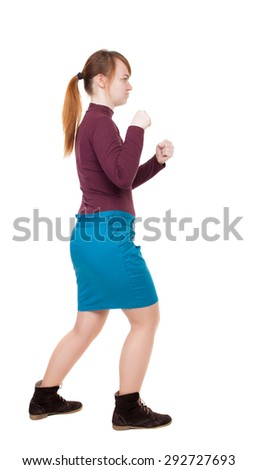 skinny woman funny fights waving his arms and legs. Rear view people collection.  backside view of person. Isolated over white background. girl in a blue skirt and a burgundy sweater fights with fists - stock photo