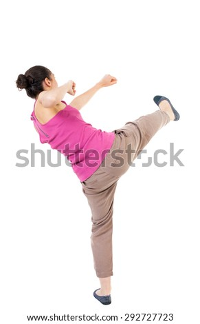 skinny woman funny fights waving his arms and legs. Rear view people collection.  backside view of person.  Isolated over white background. African-American smashes right foot. - stock photo
