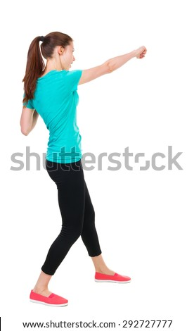 skinny woman funny fights waving his arms and legs. Rear view people collection.  backside view of person.  Isolated over white background. Sportswoman in tights slap in the face with his fist. - stock photo