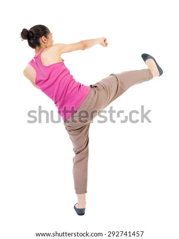 skinny woman funny fights waving his arms and legs. Rear view people collection.  backside view of person.  Isolated over white background. African-American doing lunges and kicking. - stock photo