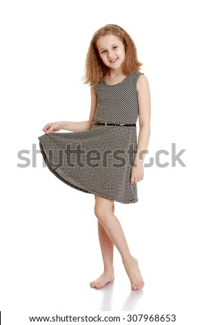 Skinny young girl stands barefoot in a gray silk short dress-Isolated on white background - stock photo