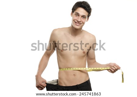 Skinny young man with large pants,anorexic look, slim body. Man lost weight and comparing his larger pants from the days he was fat. Before and after, fat or slim - stock photo