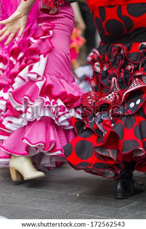 skirts of Spanish Flamenco dancers - stock photo