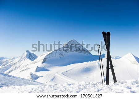 Skis in high mountains at sunny day - stock photo