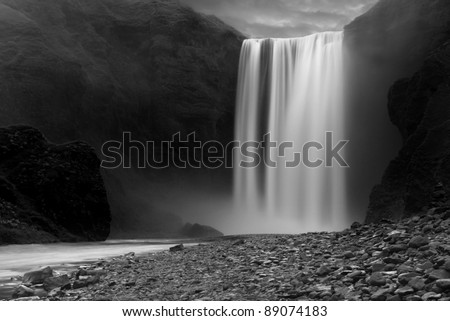 Skogafoss waterfall at night, near the small village of Skogar, South Iceland. - stock photo