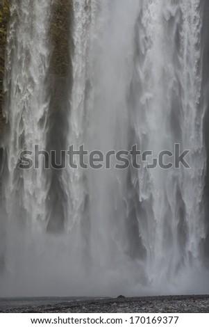 Skogafoss waterfall closeup  - stock photo