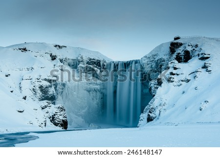 Skogafoss waterfall in Iceland during winter - stock photo