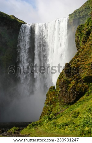 Skogafoss waterfall in southern Iceland in summer - stock photo
