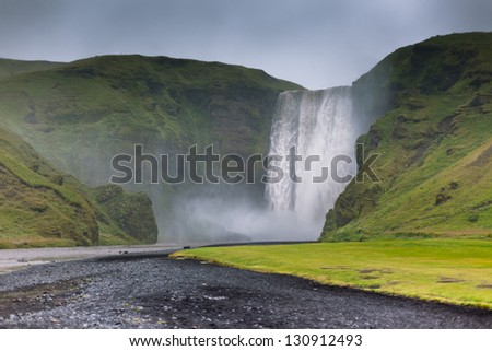 Skogafoss Waterfall, southern part of Iceland, at overcast weather - stock photo