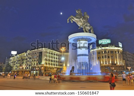 "SKOPJE, MACEDONIA - JULY 17: Square Macedonia and the central fountain with monument called ""Warrior riding a horse"" on July 17, 2013 in Skopje, Macedonia.  - stock photo"