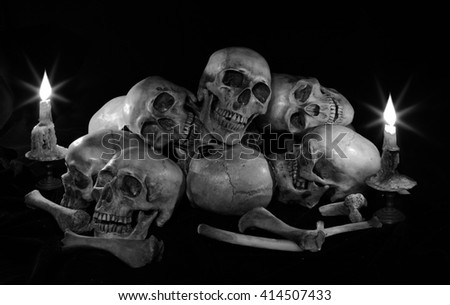 Skull and ritual on dark night with candle light / Image  black and white, Still life style