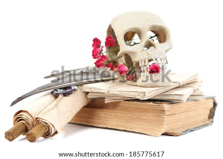 Skull, wicker heart and dried roses on old book isolated on white. Conceptual photo of love magic - stock photo