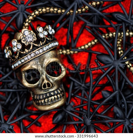 Skull with black spider and beetle decoration. Halloween background - stock photo