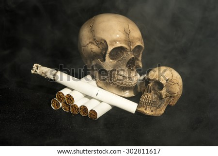 skull with cigarette - stock photo