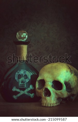 Skull with poison bottle - stock photo