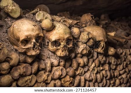 Skulls and bones in Paris Catacombs  - stock photo