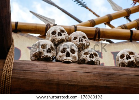 Skulls in a pirate fashion - stock photo