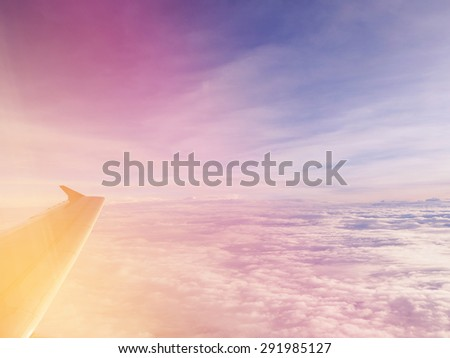 Sky and clouds. Airplane trace over the clouds and filtered image.       - stock photo