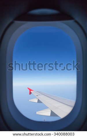 Sky and clouds looking form airplane window - stock photo
