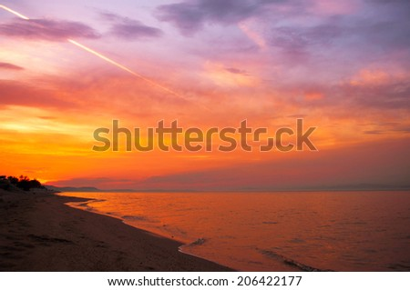 Sky and clouds over sea at sunset - stock photo