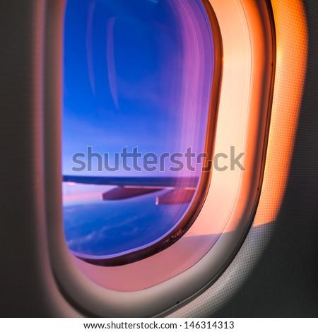 Sky as seen through window of an aircraft - stock photo