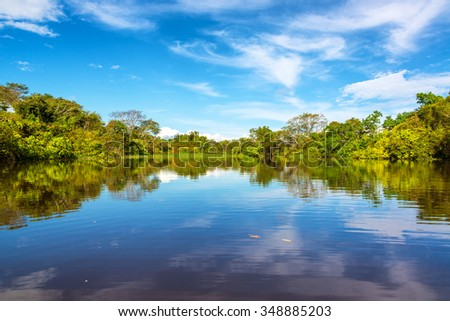 Sky being reflected in the Javari River in the Amazon rain forest - stock photo