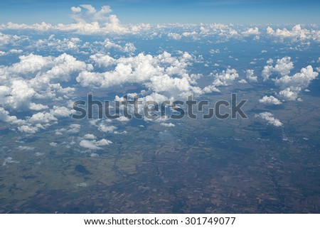 Sky clouds and land background. Top view of the plane - stock photo