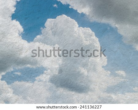 Sky, fog, and clouds on a textured, vintage paper background with grunge stains - stock photo