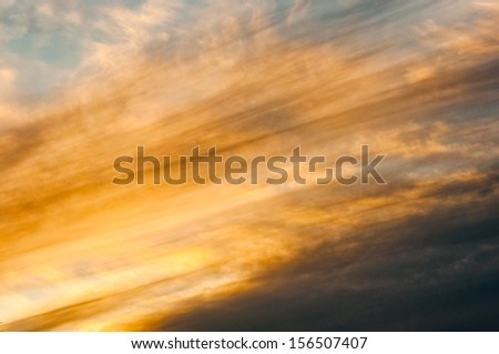 Sky full of colorful hue of sunset - stock photo