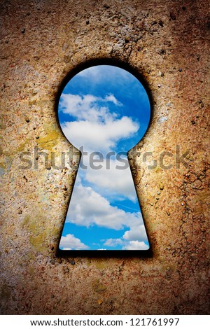 Sky in keyhole on old wall with vignette effect - stock photo