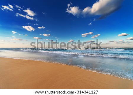 sky, ocean and beach on the sandy beach - stock photo