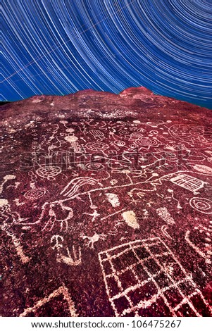 Sky Rock in the Eastern Sieras in California is made even more timeless by the effects of long exposure and star trails. - stock photo